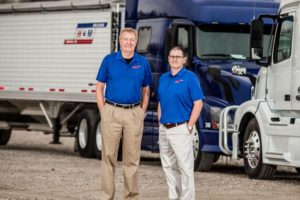 dale and randy in front of truck